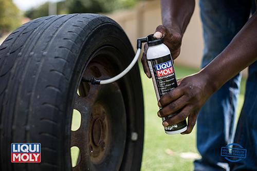 Man DIY car tire